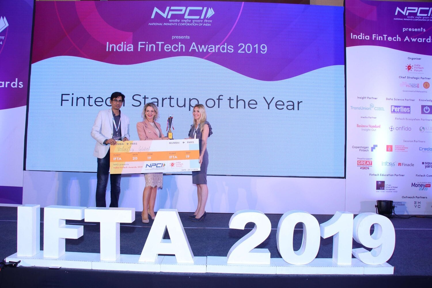 Valocity Founder and Global CEO, Carmen Vicelich receives the trophy for Fintech of the Year 2019.